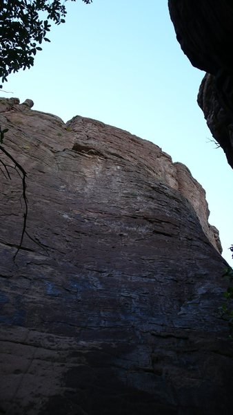 "2nd bolt of ""Two Bit"" should be visible. Clear the ""overhang"" to the left of the roof visible. Vertical crack visible up high. ""Summer Assault"" goes up the right hand arete down low to crack and face up high and right. Both climbs descend from new anchors."