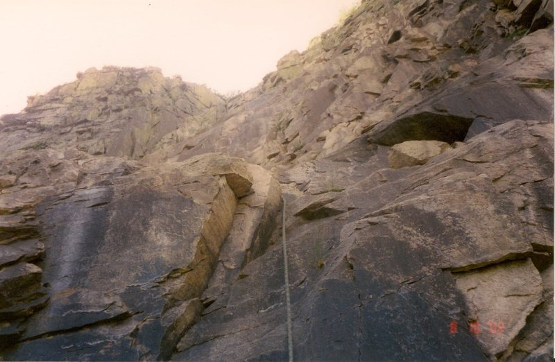 Scanned photo. This is the crux (5.5) of second pitch and the long run out before and after it.