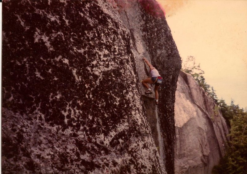 Scanned photo of Russ Klune leading through the third pitch crux. Mid 1980's