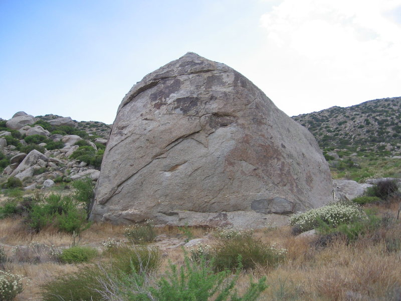 Turtle Head with Greased Lightning on extreme left and The Miser on the right-hand slab. WonderCling traverses L-R on diagonal lip.