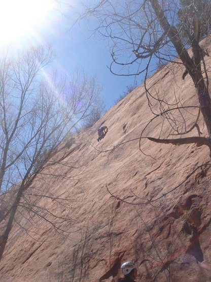 23MAR11 Red Rock Canyon O[en Space Celena's 1st .12a on slabby sandstone UP UNTIL SUNRISE (Lee Rittenmeyer leading it)