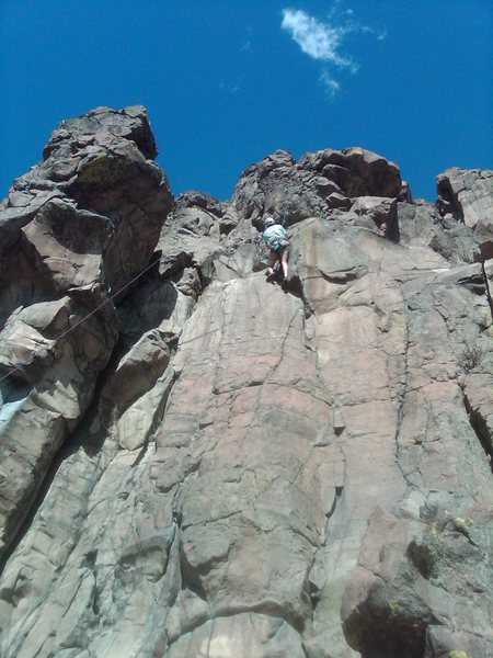 Doug finishing the crux layback sequence near the top of Cool Thing.