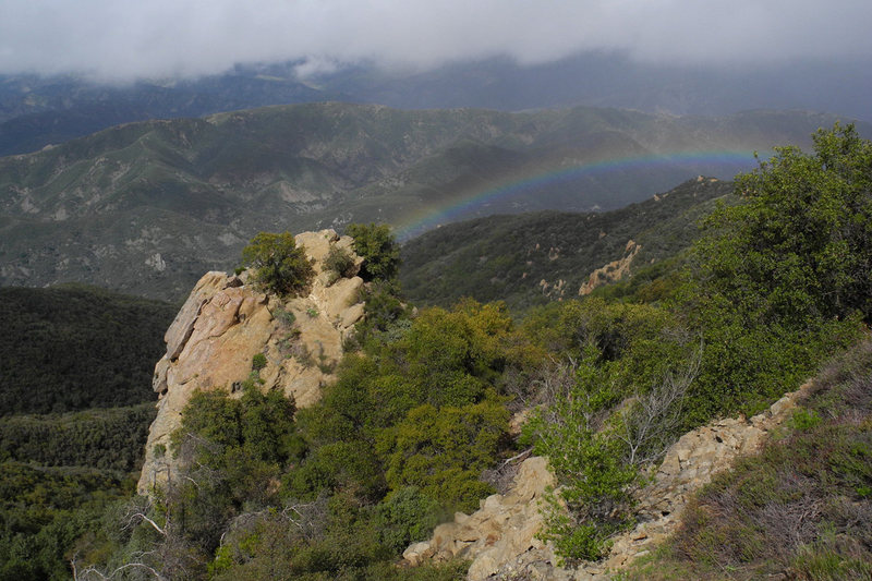 Crazy weather we're having--a brief April snow shower was followed by a rainbow that graced the top of Hermit Spire.