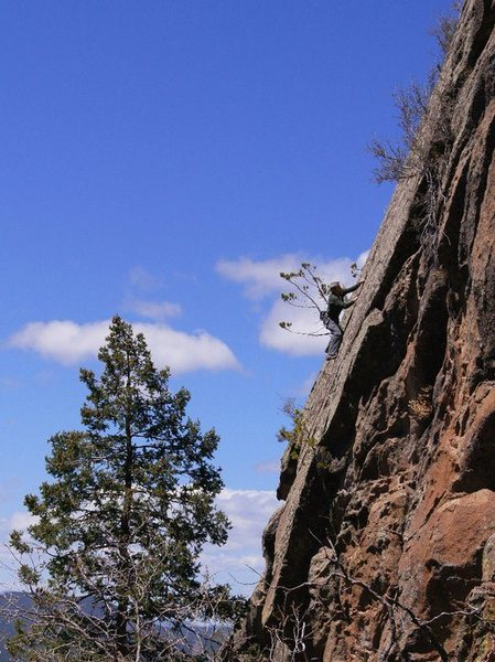 JJ working across the slaberrific crux, up high on the Thunderbird Slab during the FA.<br> <br> Wade Forrest Photo