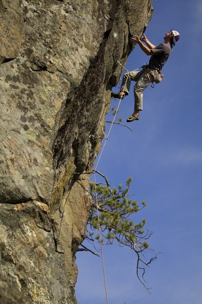 Matt McCormick closing out the crux on Wild Blue Yonder, Rumney, NH