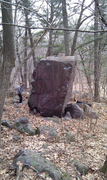 North side of Purple Haze Boulder. Right arete is Smokers Delight V1. Going left on face is Roll One Up V3.