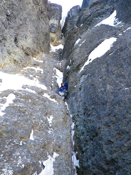 1st or second pitch.Almost no ice just a little snow on the holds. Double ropes made it a little safer as there is pro on both sides of the 15 foot wide chimney. The belay is a huge ledge with a strange cornice on it. On the left where you see that yellow rock.