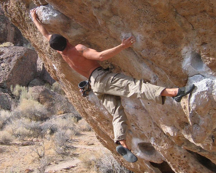 "Matt Johnson pulling the crux move on ""The Hulk"" V6 at Happy Boulders in Bishop, CA."