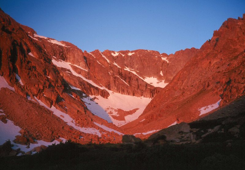 View of the upper Shelf Cirque at sunrise.  McHenry's on the left, Powell on the right.  The snowfield in the center is the approach to McHenry's Notch Couloir.
