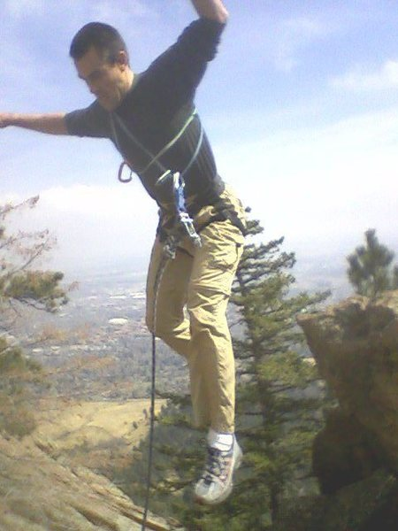 Another blurry pic of the jump move.  Rob high over Boulder.