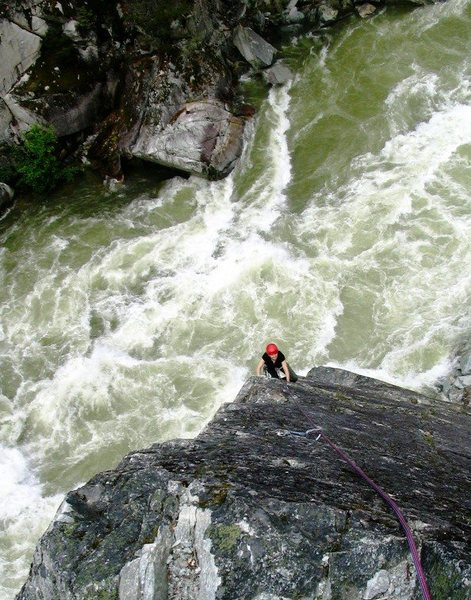 Annie Simard seconding the middle pitch of Star Chek above the raging Cheakamus River at high flow.