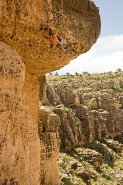 Taking the swing on Big Mouth 5.11+, Chevelon Canyon, AZ<br> <br> Dawn Kish Photo