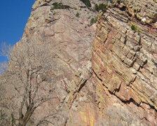 Rock Climbing Photo:  Climber stemming in orange.