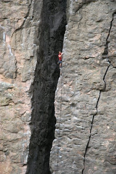 A climber high on Giveaway, 5.10a