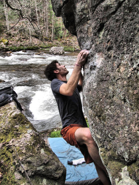 """Aaron Parlier climbing """"Pale Morning Dun""""(v3) on the Mayfly Boulder"""