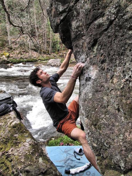 "Aaron Parlier climbing ""Pale Morning Dun (Standstart)""(v3) on the Mayfly Boulder"