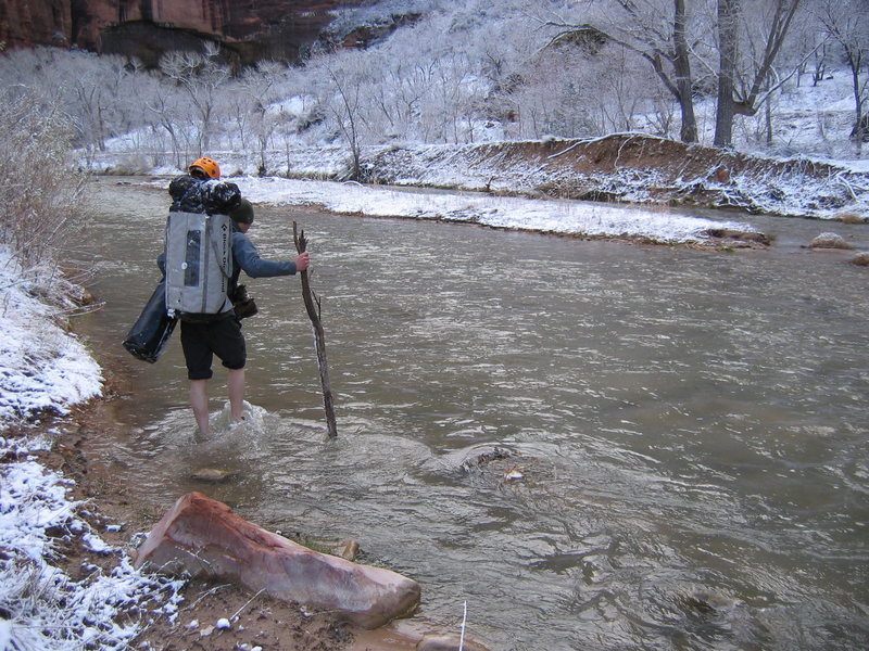 Nick Fleming fording the ice cold Virgin river at Zion National Park.<br> Photo by: Matt Johnson