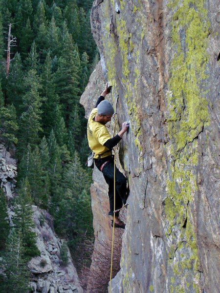 """Jay climbing on """"Inner Gorilla.""""  A cold and unforgiving 1st days work on the route with friends cheering him on!!"""