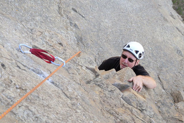"""Michael McKay ponders the crux overhang on """"The Good, the Bad & the Ugly,"""" at Crag Full of Dynamite."""