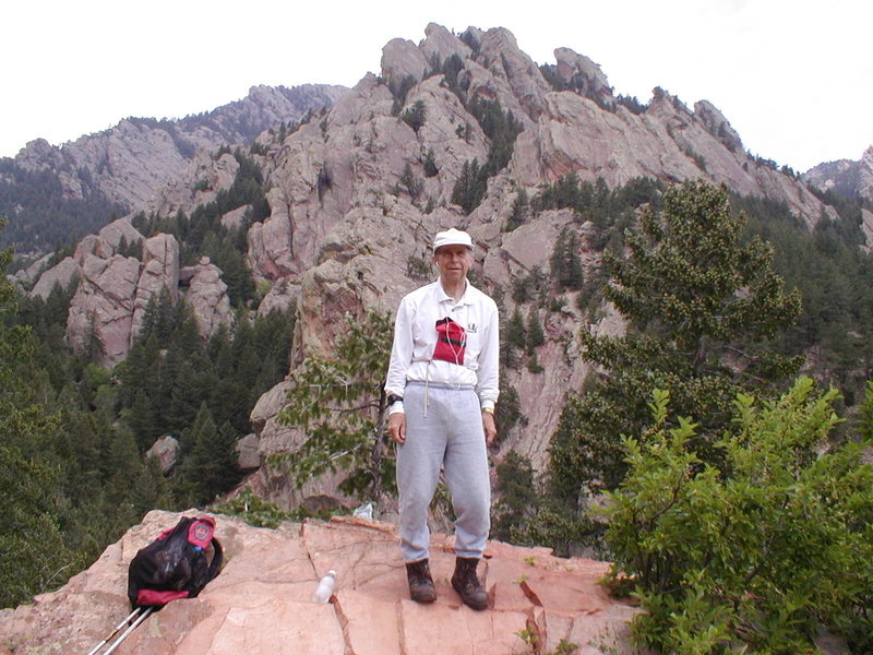 Jack Eggleston with the rocks of Dinosaur Mtn., The Flatirons, behind.