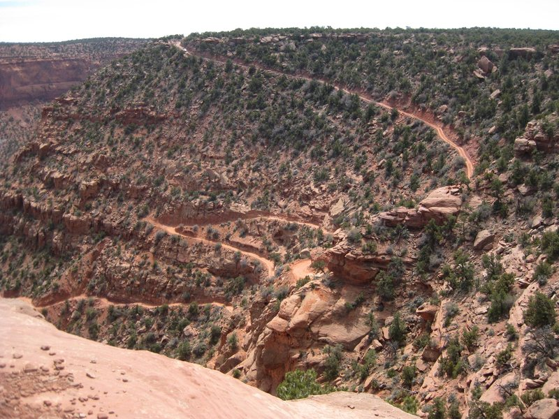 The Flint Trail switchbacks@SEMICOLON@ which was one of the easier sections of road to the Maze in Canyonlands, Utah. @SEMICOLON@ ) <br> <br> April 2011 on our way down the Flint Trail.
