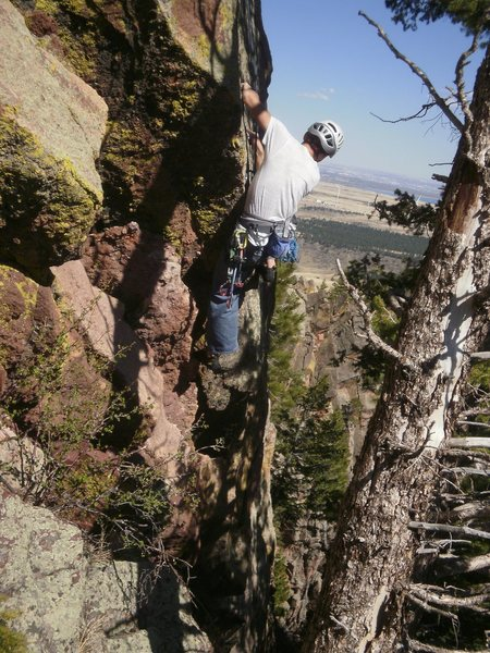 Pulling the crux behind the trees.