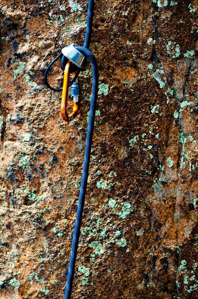 ATC and rope lying on rock
