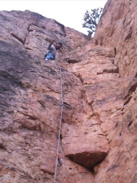 Standing on the ledge before the crux to the top.