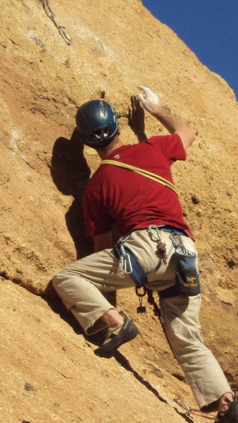 "Negotiating the crux bulge on ""Yellow Rose of Texas."""
