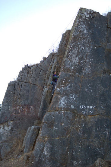 Buddy climbing the Arete