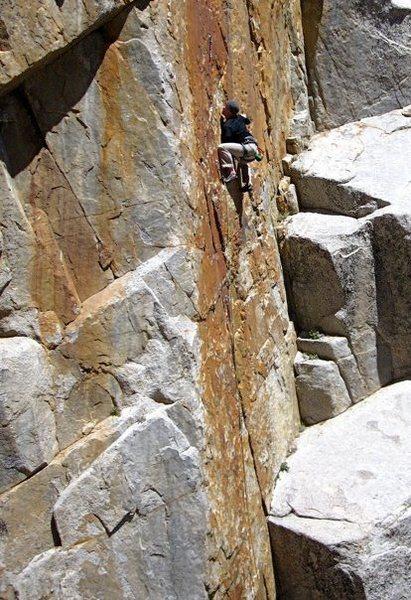 Rock Climbing Photo: High stepping the crux.