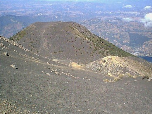 Phot shows trail over top of false summit on the way to the actual cone of the volcano.