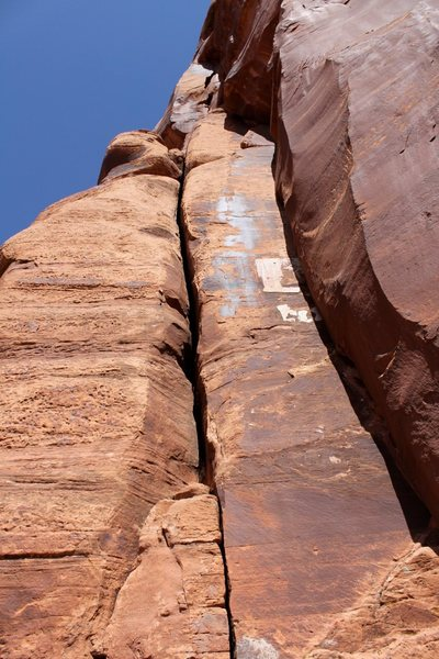 The Ooze (5.10-), Selfish Wall, Indian Creek, UT.  Route lies right of the calcite patch.  Photo courtesy Liba K at summitpost.