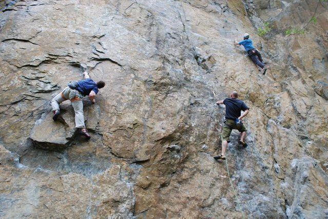 Michael Davis working the moves of Flippin' the Bird.<br> <br>  The climbers to the right are on Hinterland (middle; black shirt) and The Streak (right; white helmet).
