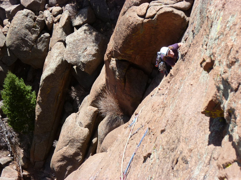"""At the top of the crack on the second pitch and about to start the traverse.  It looks like a lot of gear on the traverse, but most of it is """"no good""""."""