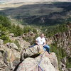 Mark Roth on the summit of the Potato Chip with Eldorado Springs far below.