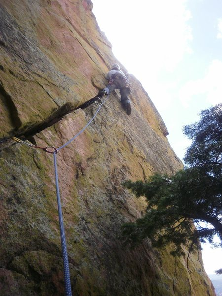 Short pitch with ever increasing difficulty.  Starting the brutal crux near the top (thin hands, no feet).
