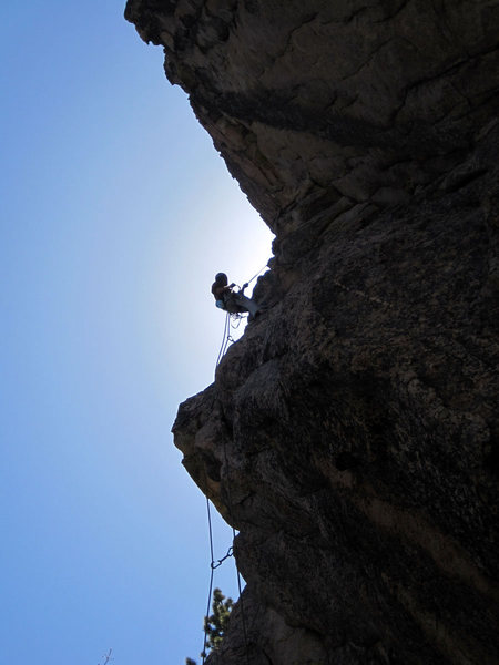 Christian Sweetsheppard rappelling after finishing the lead.