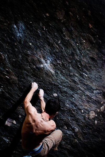"Aaron James Parlier on the tiny holds below the proper start (which is the prominent hold above the ones Im grabbing) to ""Flying Spaghetti Monster"" (V7)"