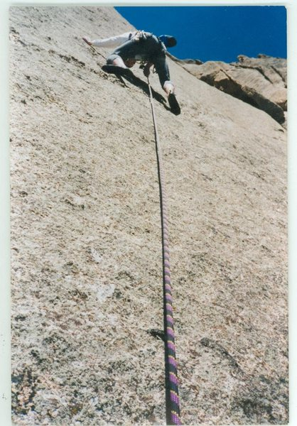 Clipping the 1st bolt of the second pitch (Climb of the Ancient Mariner) on a windy April day on Lumpy.  Photo taken by Devan Johnson.