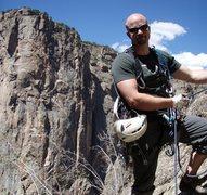 Rock Climbing Photo: Chad at the top of the pillar.