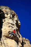 Fighting through the crux section of the route.