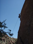 Rock Climbing Photo: Suzanne finishing the climb, silhouetted against t...