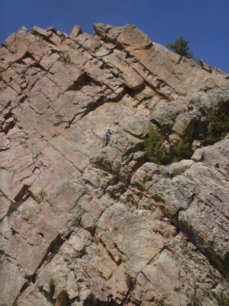 Unknown climber cruising the arete on P3.