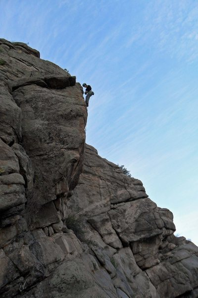 Sarah at the anchors to the unknown overhanging 5.11 route.