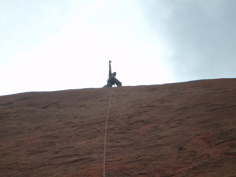 Chad Moore at the top of the route, picture is taken from the belay ledge looking straight up the route.