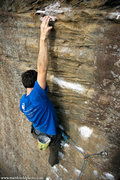 Rock Climbing Photo: Dan Apostoli reaches for the routes most prominent...