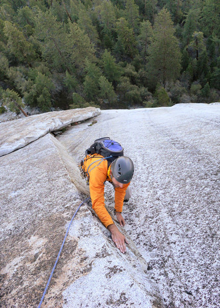 Romain Wacziarg climbs through the finger-tips layback crux on P3 of Anti-Jello Crack, Dome Rock.