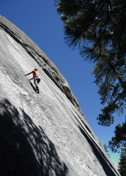 Romain Wacziarg, past the crux and cruising, on Red Mushrooms (5.10c) at Dome Rock.