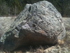 Neat little overhang to pull out of on the NW side of the boulder.